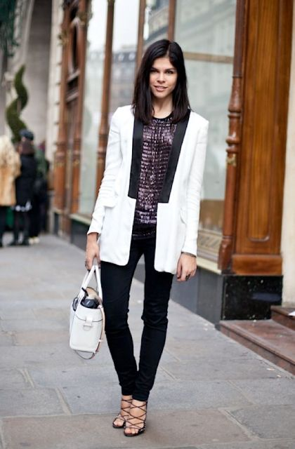 With black trousers, lace up shoes, white bag and white and black long blazer