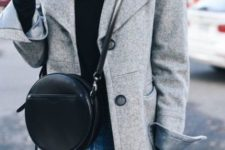 With black turtleneck, jeans and gray coat