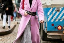 With black turtleneck, pink coat, black belt, red bag and midi skirt