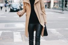 With black turtleneck sweater, black leather pants, bag and pumps
