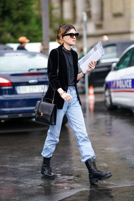With black velvet blazer, black leather bag and light blue loose jeans