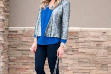 With blue blouse, cuffed jeans, chain strap bag and pumps
