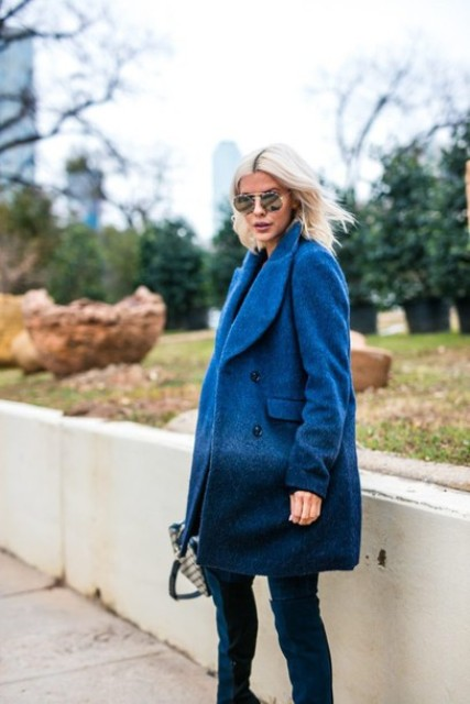With blue high boots and printed bag