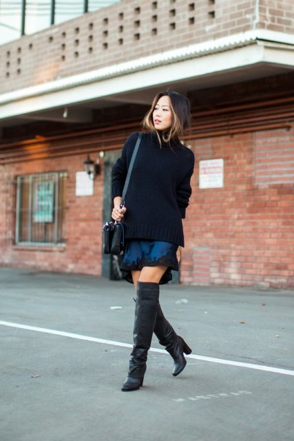 With blue lace skirt, black bag and leather boots