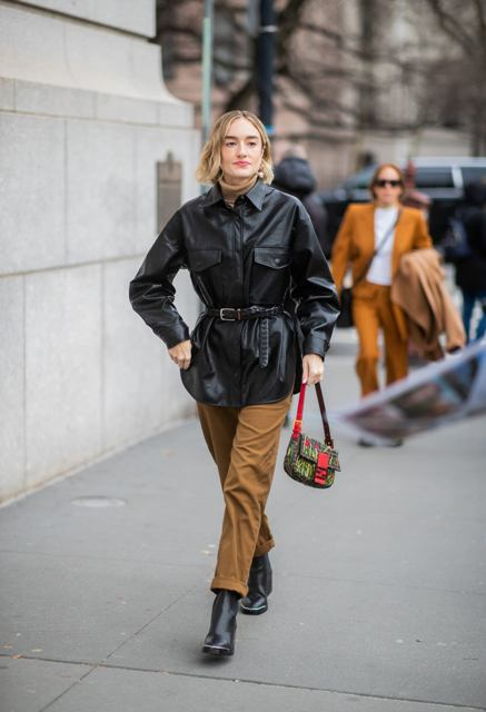 With brown pants, printed bag, black boots and brown turtleneck
