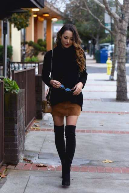 With brown suede mini skirt, chain strap bag and over the knee boots