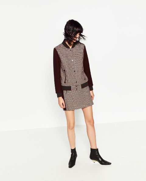 With checked mini skirt and black low heeled boots