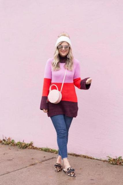 With color block long sweater, pom pom hat, skinny jeans and leopard flat shoes