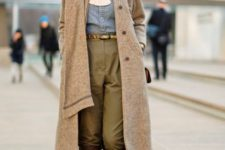 With denim button down shirt, olive green pants, belt and midi coat