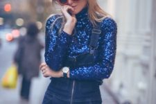 With denim jumpsuit and red framed sunglasses