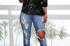 With distressed cuffed jeans and beige high heels