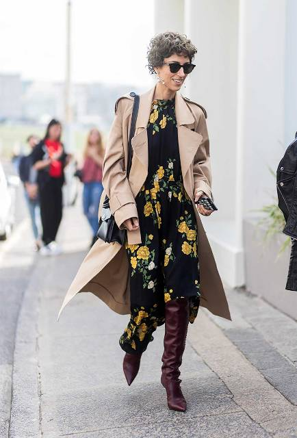 With floral midi dress, beige coat and black bag