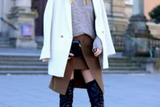 With gray loose shirt, brown wrapped skirt, black clutch and white long blazer