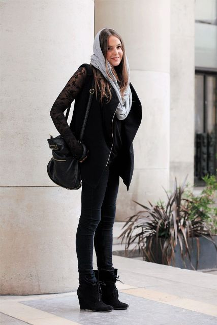 With gray scarf, lace shirt, black vest, skinny pants and bag