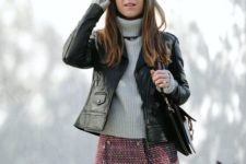 With gray sweater, black leather jacket, black bag and over the knee boots