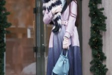 With gray sweater, cuffed jeans, light blue bag and black ankle boots