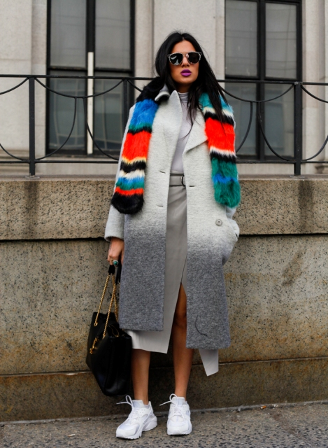 With gray turtleneck, gray midi skirt, white sneakers and chain strap bag
