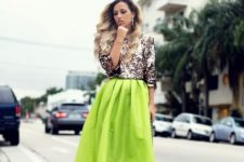 With green skirt, bag and beige pumps