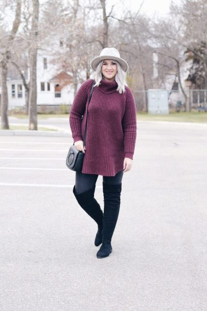 With hat, skinny jeans, black over the knee boots and black bag