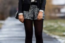 With jacket, chain strap bag, black tights, platform shoes and white and black blouse