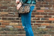 With jeans, black shoes and leopard bag