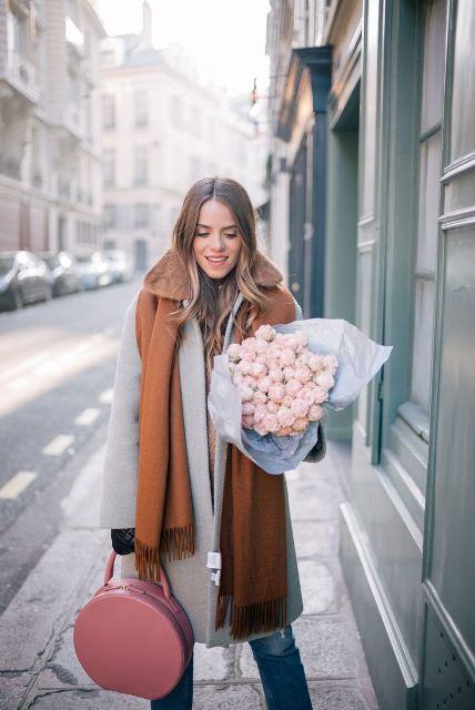 With jeans, gray coat and brown scarf