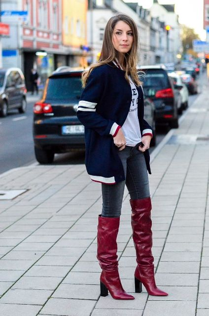 With labeled t-shirt, skinny jeans and long bomber jacket