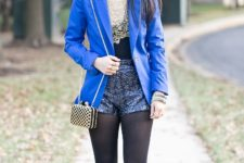 With lace shirt, pumps, blue blazer and chain strap mini bag