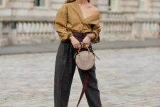 With loose one shoulder blouse, wide leg cuffed trousers and printed high heels