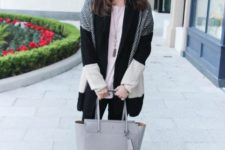 With loose shirt, black pants, gray leather tote bag and black shoes