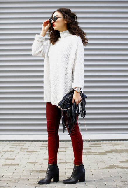 With marsala pants, black leather boots and black fringe bag