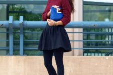 With marsala sweater, skater skirt, blue clutch and black tights