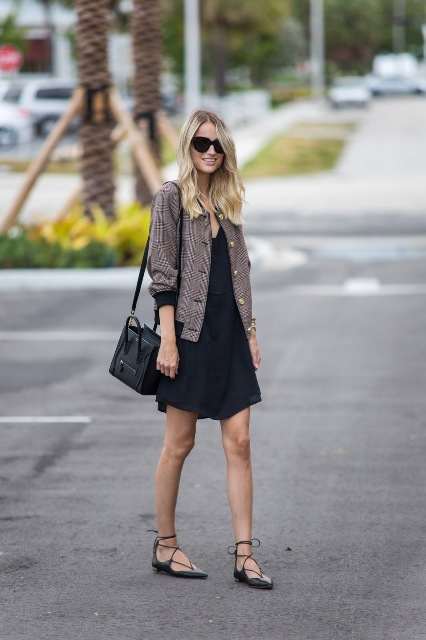 With mini dress, lace up flat shoes and black bag