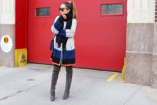With mini skirt, black scarf, black tights, navy blue bag and gray over the knee boots