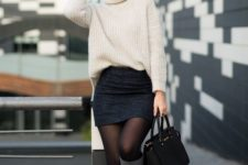With mini skirt, black tote bag and gray high boots