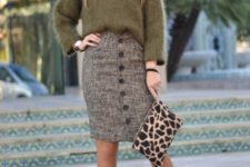 With olive green sweater, leopard clutch and black pumps