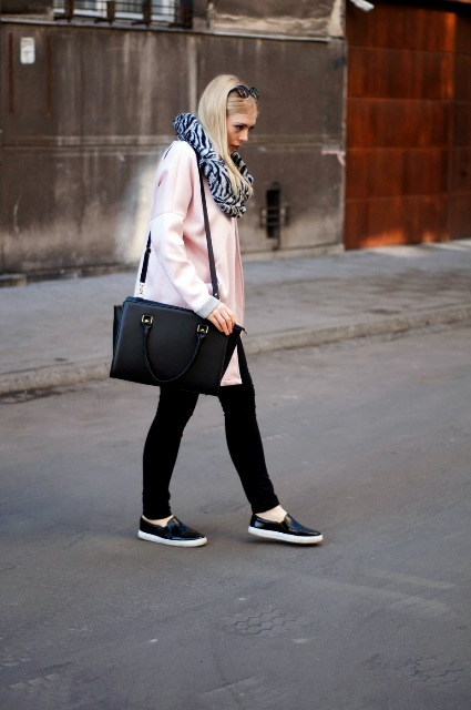 With pale pink coat, black bag, skinny pants and flat shoes
