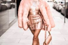 With pale pink fur coat, leather bag and pumps