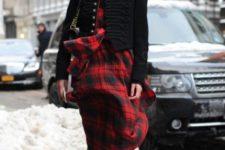 With plaid skirt, black blazer, black shirt and bag