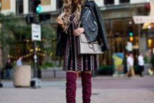 With printed mini dress, gray bag and black leather jacket