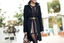With printed mini dress, high heels and brown bag