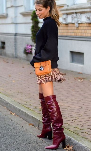 With printed mini skirt, orange bag and black sweater