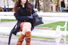 With printed skirt, black blouse, navy blue trench coat and bag