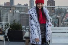 With red hat, red sweater, embellished skirt, black bag and printed faux fur coat
