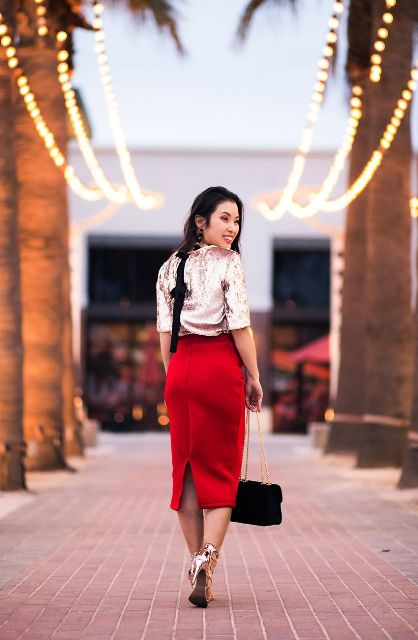With red midi skirt, black velvet bag and golden shoes