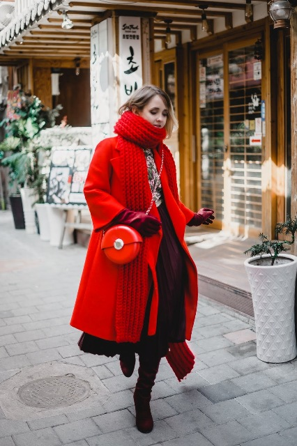 With red oversized scarf, red midi coat, A-line skirt, printed blouse and marsala high boots