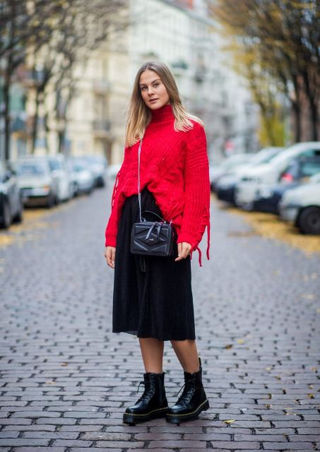 With red oversized sweater, black midi skirt and chain strap bag