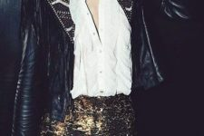 With ruffled blouse, black embellished jacket, cap and clutch