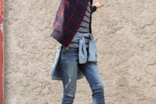 With striped t-shirt, denim shirt, cuffed jeans and black sneakers