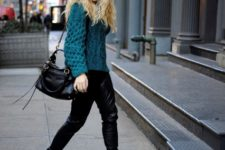 With sweater, black leather pants and black bag